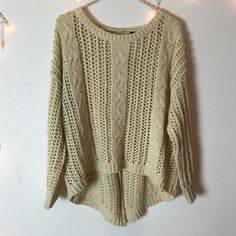 Cream Knit Sweater Gorgeous cream color and high quality knit. Hi low style with buttons in the back. Super cute with a white undershirt. Not Brandy. Good for a small or medium Brandy Melville Sweaters Crew & Scoop Necks