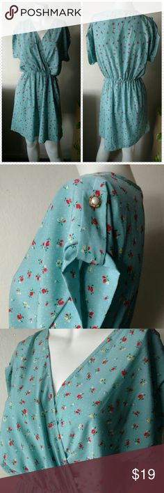 """Tiffany blue romantic floral print dress """"Everly"""" vintage inspired floral print dress. Features a wrap front, pretty button embellishments on the sleeves, and an overall romantic feel. It does have belt loops and would look nice belted with a neutral leather belt. Size small. Excellent condition. Everly Dresses"""