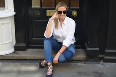 Camila Carril wears the Boden white Boyfriend Shirt, skinny jeans and Lille Lace Up navy flats. Click though for links. July 2015.