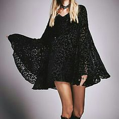 """Free People Burnout Velvet Trapeze Boho Mini Dress Witchy woman boho dress from Free People Size xs Can work for xs/s tried on but unworn (FP doesn't put tags on online merch) NWOT Rp $300+ tax babydoll dress with huge exaggerated Stevie Nicks worthy sleeves & cowl neck Black burnout velvet Dress is sheer but comes w/ a short black basic spaghetti strap slip or wear skivvies you want to show off under nylon - rayon blend USA made It's a shortie -at 5'8"""" I feel it a bit shorter than I am…"""