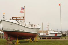 """The CG44301, the first built and longest-serving 44-ft. MLB (1963-2009), and now on permanent display at USCG Station Chatham, was celebrated with an official unveiling ceremony on May 6, 2016. The Gold Medal lifeboat CG36500 was also in attendance.  (Bernie Webber was the coxswain of the CG36500 during its historic rescue of the """"Pendleton"""" crew and also was involved in testing the prototype 44-footers.)  To learn more about these vessels, visit http://www.uscg.mil/d1/staChatham/Boats.asp"""