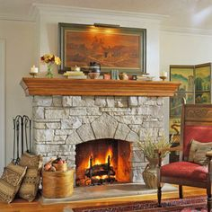 Made from stacked limestone, this fireplace serves as a focal point for the room. The hefty mantel is a good counterpoint to the heavy stone surround and provides ample display space for an array of items.