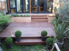 Nicely rendered planter boxes compliment the deck. Like how it flows from one deck to the next and it is perfect for a smaller space and to expand to include a screened porch later