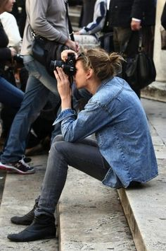 Such good style. Black shoes, grey pants, blue botton up. Add a camera, what more do you need?