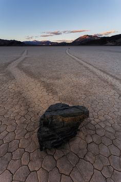 https://flic.kr/p/C7rcqf | The Racetrack - Death Valley | Sunset on the Racetrack in Death Valley National Park. Made it out here after a 3-hour drive in a 2wd passenger vehicle on the rough gravely road. A lovely place to be as the sun goes down. If you are looking for the moving rocks seen here, most of them can be found near the southern end of the playa. We were the last people out here and were able to experience absolute solitude as we walked back in the desert twilight.