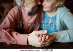 Close-up of senior female hand in that of her husband by Pressmaster, via Shutterstock