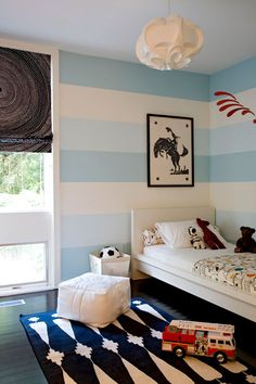young boys bedroom, pale blue wide striped walls - maybe in neutrals?