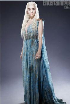 The Queen, Stormborn, Daenerys Targaryen, mother of dragons, Khalessi of the Great Grass Sea.    I can't remember more. Emilia Clarke portraying Daenerys Targaryen, dress with Qarth's clothes.