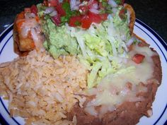 Authentic Mexican Style Shredded Beef and Bean Chimichanga with Mexican Rice and Refried Beans