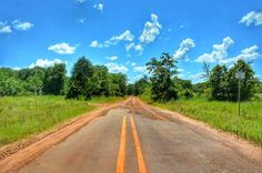 The fun begins where the pavement ends! Get off the beaten path and discover East Texas.  Photo taken in Houston County where the red dirt roads are plentiful and the countryside is beautiful.