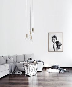 Adorable Minimalist Living Room Designs with grey sofa, pendant light bulbs and black&white wall art