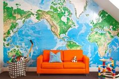 Ideas for the boys' room. Love the map & the bright orange couch.