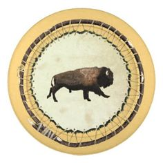 Galloping Bison Pack Of Large Button Covers A galloping bison is painted on the skin side of a beaver pelt stretched on a willow hoop. The bison (Bison bison), the largest land mammal in North America, is considered a keysto...