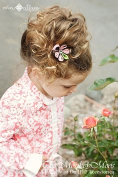 hair flower made with fabric... loads of options on this etsy shop... (The Monkey Moos)