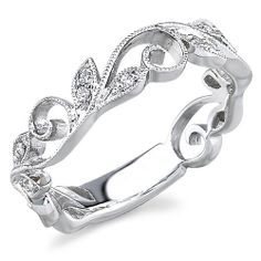 Love this leaf accented band! Reminds me of lace with the cut out designs. This would even make a great wedding band! 795.00 Dollers