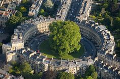 BATH, SOMERSET: A circular row of grand houses in St James's Park look on a giant tree