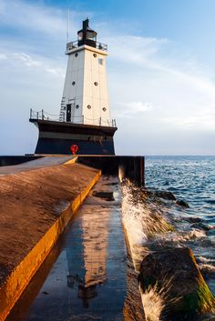 Ludington, Michigan Lighthouse Reflections and Splashes by Kenneth Keifer