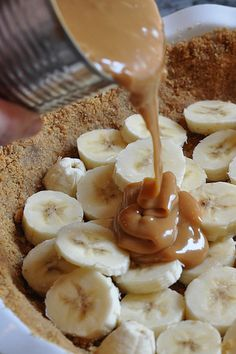 Sinful Banana Pie  •	3 bananas   •	1 tin of sweetened condensed milk   •	2 cups whipping cream (or use cool whip)  •	1 package of graham crackers (or use graham crust)  •	1 stick of butter (omit if using premade crust)  •	1 tsp vanilla   •	1 small bar of chocolate   Your first step can be done way ahead of time (at least hours but can be as much as months before). Remove the label on the condensed milk and submerge the unopened can in pot of water. Cover and boil for 2.5 hours. Warning: Be sure to keep the can covered by water at all times!!   After required time has passed, take pot off the stove and allow the can to cool. In case you're wondering – you just made toffee!   To make the crust (*You can skip this step entirely by buying a ready made graham cracker crust.)  •	Grind up crackers in food processor.   •	Melt stick of butter in microwave and pour into crumb mixture.   •	Blend until you have a moist sand mixture.   •	Smooth wet crumbs into pie plate to make a crust.   •	Bake at 350F for 10 minutes.   •	Set aside to cool.   To make whipped cream (*You can skip this step entirely by using cool whip. )  •	Whip cold cream and vanilla on high until whipped  •	Set aside   Cut up bananas into slices and lay into your crust. It doesn't matter how you arrange them really. Just go wild.   Open toffee can, mix with knife until smooth, pour on bananas.   Spread whipped cream over the whole mess   Grate chocolate on top (optional)  Put in fridge to set for at least 1 hour