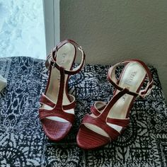 WHBM......UPDATING SOON....... ....GREAT CONDITION  ....NORMAL WEAR ....NO FLAWS .... ....BEAUTIFUL  ....true to its size and color ....color....red burgundy. ....silver lining  ....wedge sandals  ....open toe ....ankle straps ....2 pic up close ....snake design feel... ....4 pic shows bottom sole...some wear. ....better in person.. White House Black Market Shoes Wedges