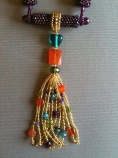 Gold & Purple Netted Tassel Necklace with Carnelian and Amethyst by Jeka Lambert, front detail.  Seed bead woven.  Seed beads, carnelian, amethyst, glass beads.