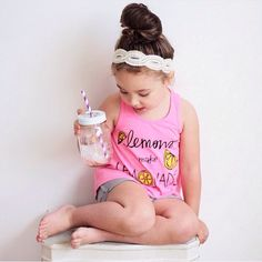 Our Lemons make Lemonade Racer Back High Low Bright Pink Tanks are in our Shop! Loving this pic from @fruitsnacksandflannel // Headband: @willowcrowns  Shorts: @finomenonkids  Mason Jar Cup: @sprinkled_joy // Sold Out Sizes will be restocked at the end of the month! Pullovers, Tees, Tanks & Art Prints in Our Shop!!