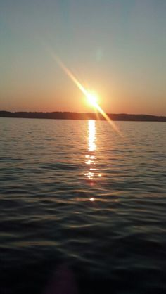 Sunset on Torch Lake. Looks like it's from 7798 Maguire Lane ;)
