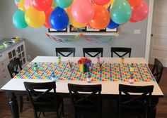 Art party -- craft paper (white), with wrapping paper runner, plus good 'ol fashioned paper chains.