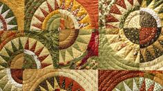 Busy Bee No. 16: A New York Beauty Christmas Quilt.  I believe that this detail shot shows the truer colors.