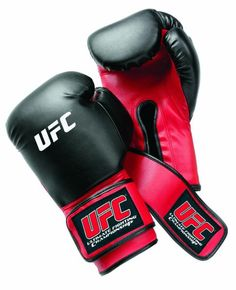 UFC Mixed Martial Arts Heavy Bag Gloves: Pre-curved design reduces hand strain Polyurethane exterior Multiple foam layers provide a soft interior Extra-wide strap for wrist support Imported Model Mma Gloves, Boxing Gloves, Boxing Hand Wraps, Midwest City, Ufc Boxing, Mma Gear, Mma Equipment, Training Equipment