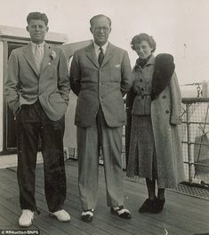 Two of the images have never been published before including one of Kennedy (left) with family members on a ship