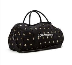 COUNTRY ROAD Gold cross and black tote bag