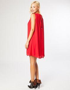 Φόρεμα mini, αμάνικο, με πιέτες, στρογγυλή λαιμόκοψη και κλείσιμο με κουμπί στο πίσω μέρος.