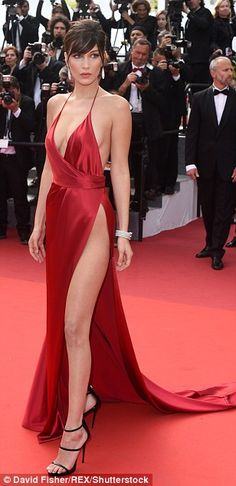 Bombshell Bella Hadid upstages everyone on the red carpet as she goes underwear-free in a plunging scarlet gown with soaring split at Cannes Film Festival premiere of Unknown Girl | Daily Mail Online