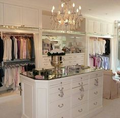 Love the chandelier and sitting area in this beautiful closet.