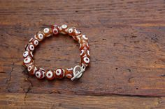 Orange Evil Eye Glass Beaded Bracelet by BeTheDreamerJewelry on Etsy