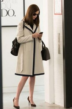 Anne Hathaway the Intern Anne Hathaway wearing Barneys New York Pleated Leather Skirt, Martin Grant Contrast Trimmed Trench Coat, Valextra Triennale Satchel, Cartier Tank Solo Watch and Ray-Ban Rb4165 Justin Sunglasses