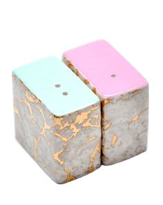 Atomic marbled ceramic salt and pepper shakers in mint and pink.