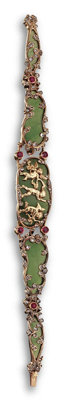 NEPHRITE, RUBY AND DIAMOND BRACELET, FRENCH, CIRCA 1880.  Composed of five nephrite plaques of cartouche shape, the center plaque depicting three gold frolicking putti, decorated throughout with small rose-cut diamonds and linked by 6 collet-set round rubies, mounted in 18 karat gold, length 7¼ inches, assay marks, 2 diamonds deficient.