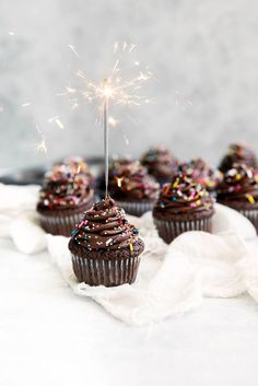 Rich brownie-like birthday cupcakes topped with sinful chocolate frosting and, of course, SPRINKLES!