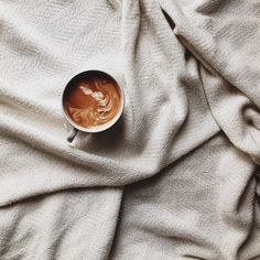 A cup of coffee in a bed