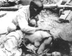 The Rape Of Nanking--Chinese woman  gang- raped by Japanese soldiers then murdered . Her mournful husband weeps over his wife's brutalized corpse.