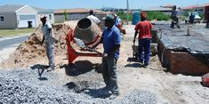 workers mixing concrete