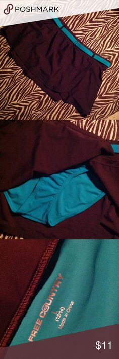 Size large swim skirt Size large never worn without tags chocolate brown and turquoise swim skirt. 12-14 Free Country Swim Bikinis