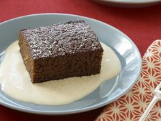 Gingerbread with Spiced Creme Anglaise - Guinness adds rich flavor to this dense spice cake. Serve it with cream infused with orange zest, cinnamon, cloves and ginger.