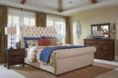 Loving the beautiful Windville upholstered bed, perfect for your bedroom. Get yours at Ashley HomeStores!