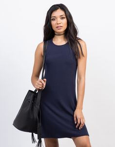 This Ribbed Flowy Tank Dress will get you through your busy day in full comfort. Comes in a navy or olive color of your choice. You can pair this dress with black strappy sandals and a bucket bag to complete your look!