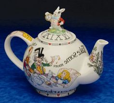 Alice in Wonderland 2-Cup Teapot. This site has fancier decorative items and favors for the not-so-limited budget.