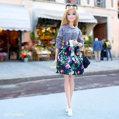 Street chic in a printed floral skirt paired with sneakers.