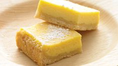 The lemon bars of your dreams take just 15 minutes of prep: Stir together a mere three ingredients to create a sunny, puckery filling for a buttery shortbread crust. Lemon Desserts, Lemon Recipes, Just Desserts, Sweet Recipes, Delicious Desserts, Yummy Food, Lemon Squares Recipe, Cookie Recipes, Dessert Recipes