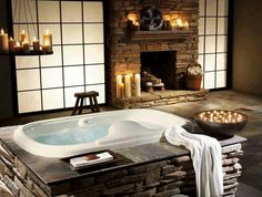 Love the warm feel of this bathroom! Love the fireplace!